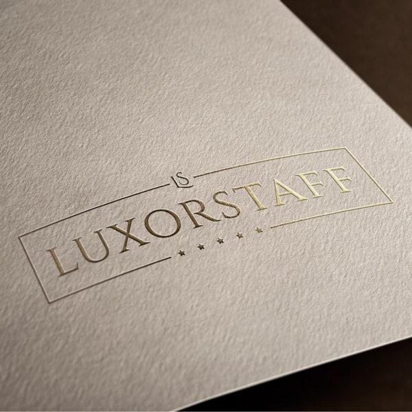 logotipo da Luxor Staf